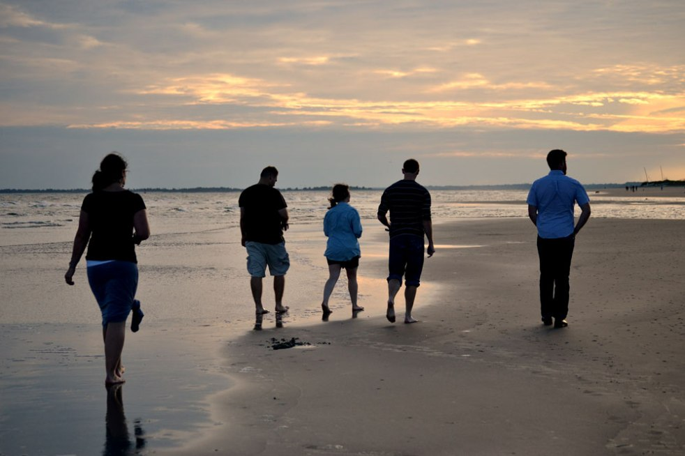 outline of Kyla, Brandi's husband, Brandi, Jac and Jacob walking on the beach at sunset