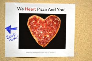 "Picture of heart shaped pizza with text ""He Heart Pizza and You"""