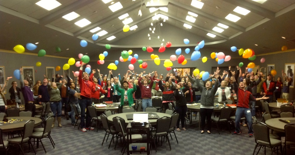 Image of Tutors throwing colored balloons in the air