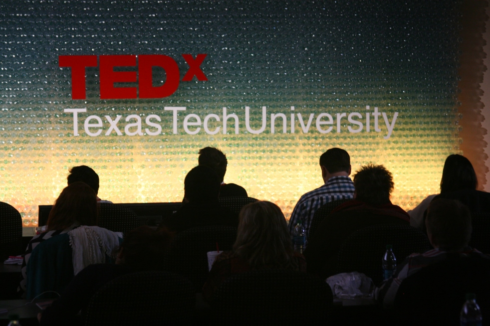 Audience members looking at TEDx Texas Tech University Stage