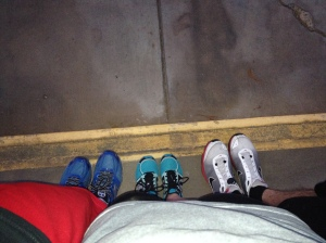 Three tennis shoes on the starting line
