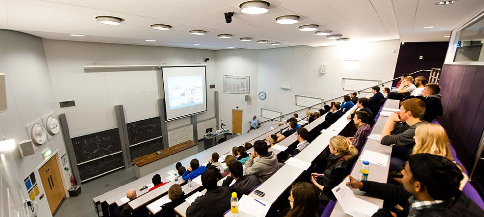 Students in lecture looking at white board