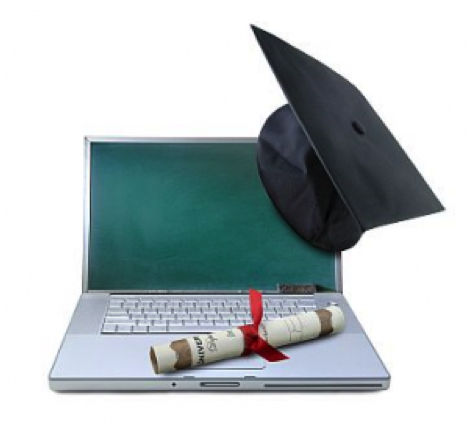 Computer with graduation cap and diploma