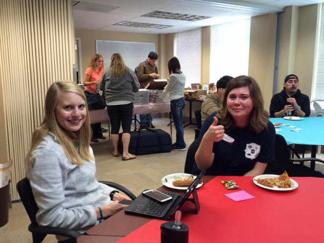 tutors enjoying appreciation day. Becca giving a thumbs up and Jordan smiling!