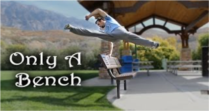 "A man leaping over a bench, with words overlaying the grass that reads ""Only a Bench"""