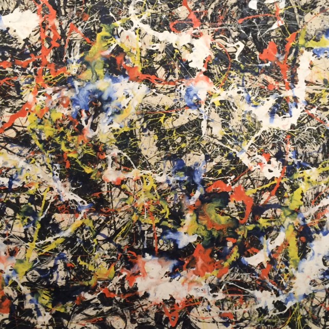 A close up of a Jackson Pollock painting.