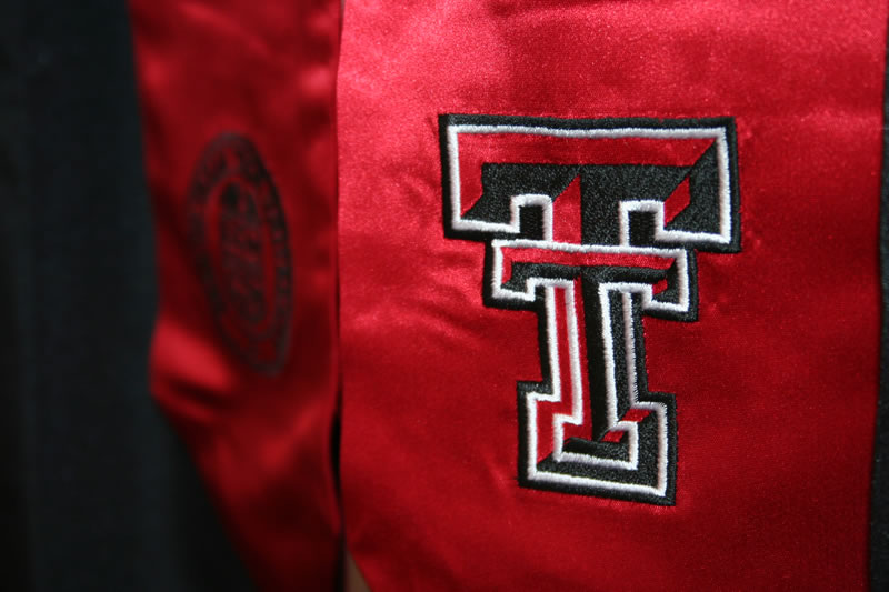 Close up of a graduation stole with the Texas Tech Double T emblem and Texas Tech seal