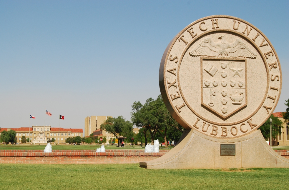 A scenic shot of the Texas Tech Official Seal statue with Memorial Circle in the background