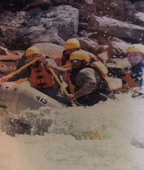 A group of men white water rafting